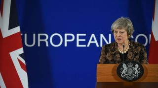 Theresa May speaks during a press conference on December 14, 2018 in Brussels
