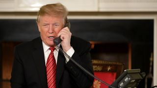 President Trump chats to children on the phone on Christmas Eve