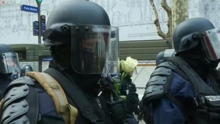 Flowers given to police during protest