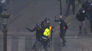 Protester hit by baton and dragged away