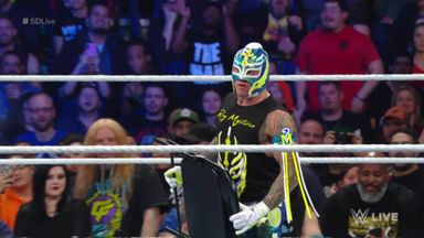 Mysterio attacks Orton with chair