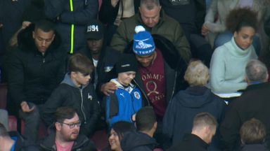 Mounie plays Santa for Terriers fans