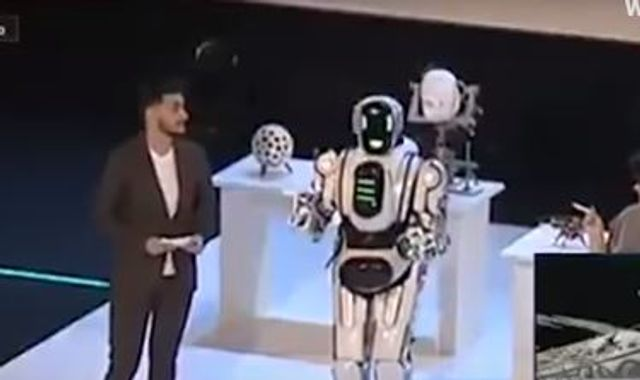 lbc.co.uk - Russia's State-Of-The-Art Robot Exposed As Man In Costume