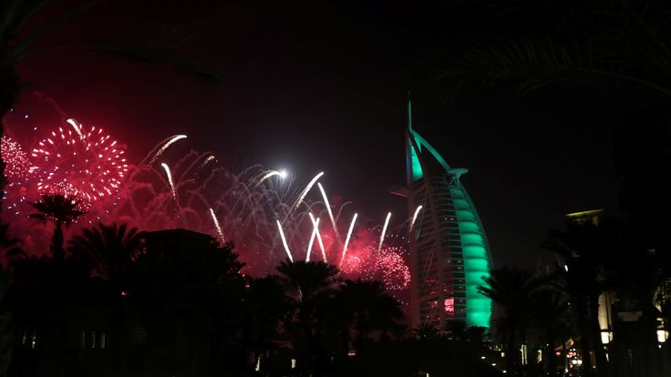 Fireworks explode over the Burj Al Arab hotel during the New Year celebrations in Dubai