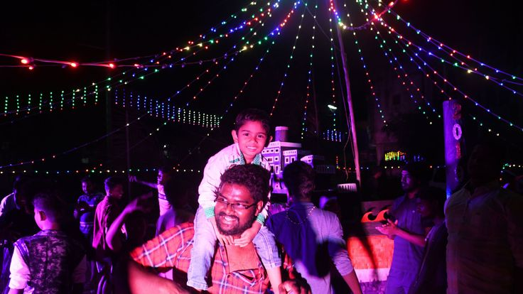 Indian youth welcome the New Year as they celebrate at a residential area in Chennai on January 1, 2019. (Photo by ARUN SANKAR / AFP) (Photo credit should read ARUN SANKAR/AFP/Getty Images)