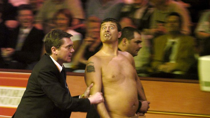 Mr Roberts is escorted away after streaking at the World Snooker Championships in 2004