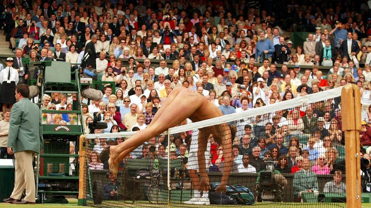 Mr Roberts jumps over the net during a break in the men's single final between David Nalbandian and Lleyton Hewitt at Wimbledon in 2002