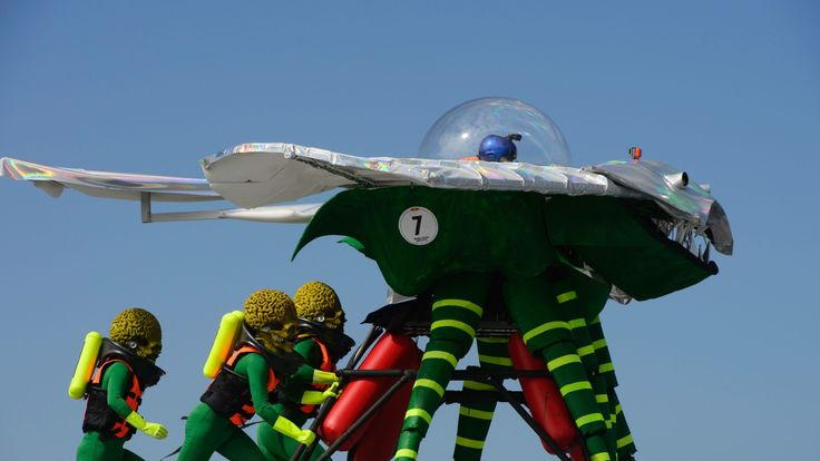 Participants dressed as alien characters from the film 'Mars Attacks!' launch their flying contraption during the Red Bull Flugtag event in Hong Kong on November 27, 2016. The Flugtag -- which means 'flying day' in German -- is a competition in which teams in fancy dress attempt to pilot human-powered, home-made flying machines off a platform into water. / AFP / TENGKU Bahar (Photo credit should read TENGKU BAHAR/AFP/Getty Images)