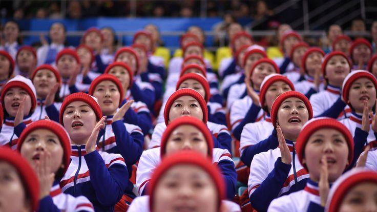North Korean cheerleaders watch the united Korea's ice hockey team at the winter Olympics