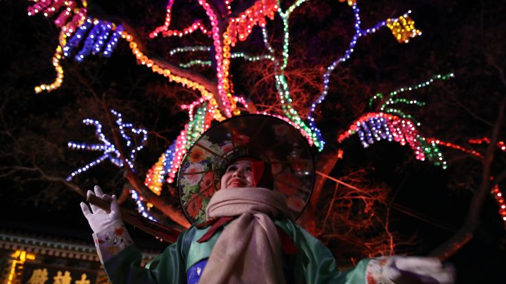 A woman celebrates the New Year at Jogyesa Buddhist temple in Seoul, South Korea