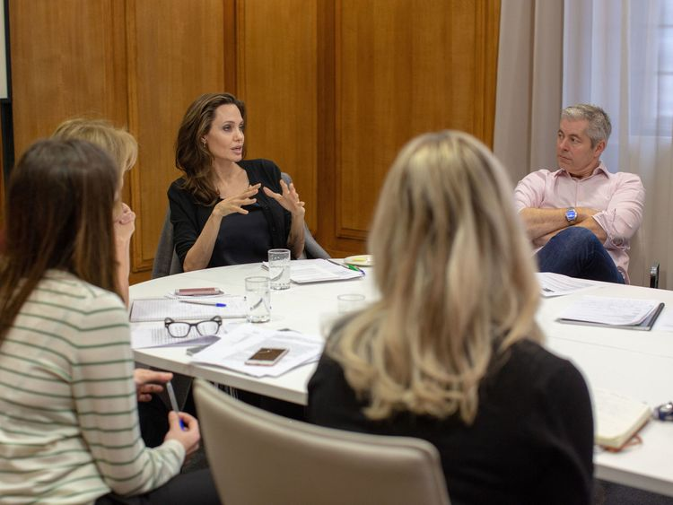 """Undated BBC handout photo of Angelina Jolie (centre) who has said she hoped to """"bring people together from a cross-section"""" during her turn as a guest editor on Radio 4's Today programme."""