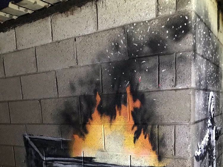 A possible new artwork by street artist Banksy, which has appeared on a garage wall in Taibach, Port Talbot. Pic: Andrew John/PA Wire