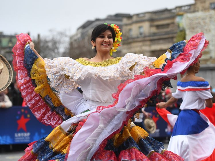 Bolivian dancers perform in Trafalgar Square, London, during a preview event for the New Year's Day Parade 2019.