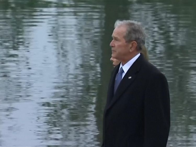 George W Bush follows his father's coffin to the burial site at the presidential library in Texas