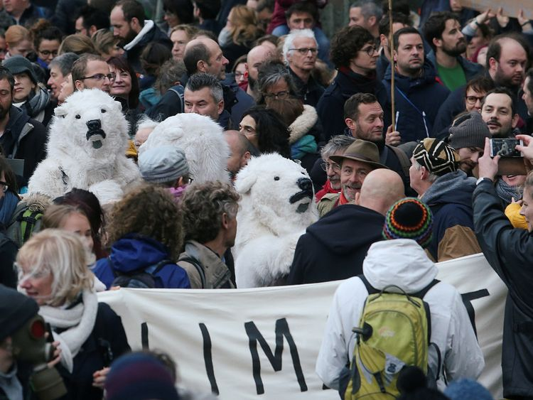 Tens of thousands protest as climate summit begins