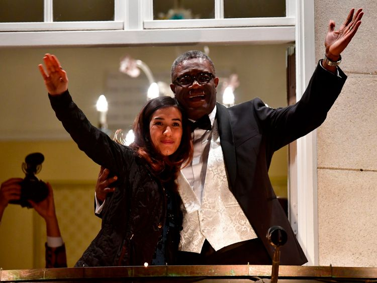 Nobel prize laureates Congolese gynaecologist Denis Mukwege (R) and Iraqi Yazidi-Kurdish human rights activist Nadia Murad greet the crowd from the balcony of the Nobel suite in Oslo downtown, Norway on December 10, 2018