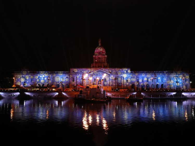 Coloured lights are projected onto Dublin's Customs House during a test for the city's New Year's Eve festival which kicks off tomorrow with a family-friendly Liffey Lights sound and light show.