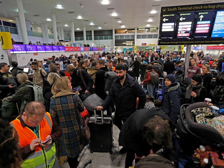 Passengers are waiting in the South Terminal building at Gatwick Airport