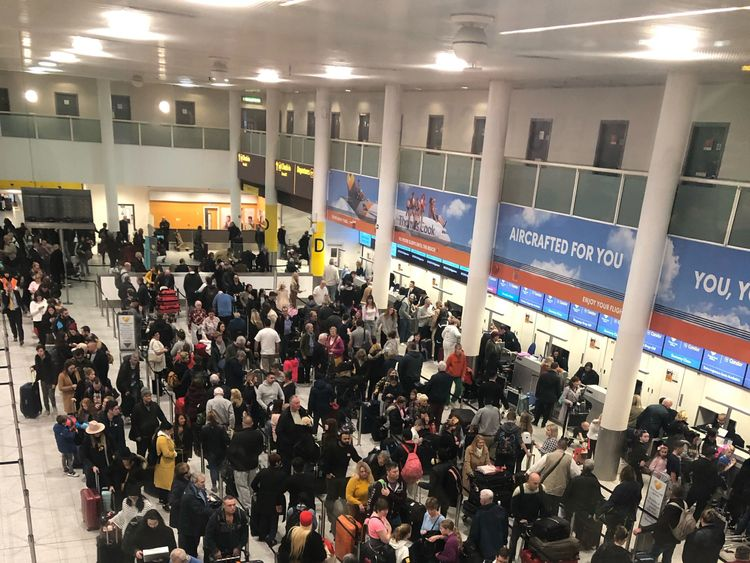 Queues of passengers in the check in area at Gatwick Airport