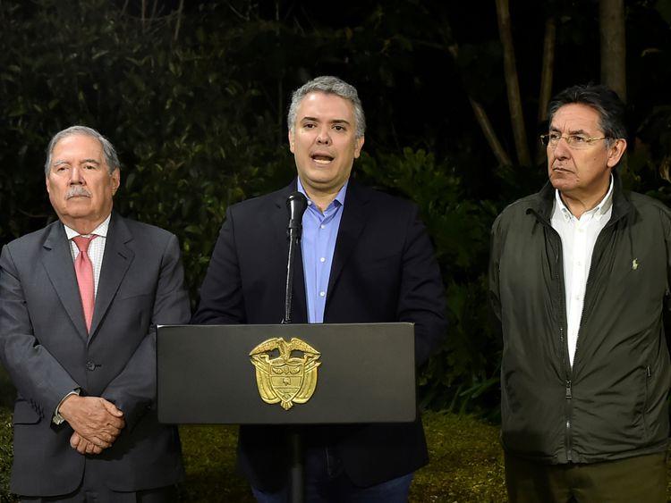 Colombian president Ivan Duque (centre)