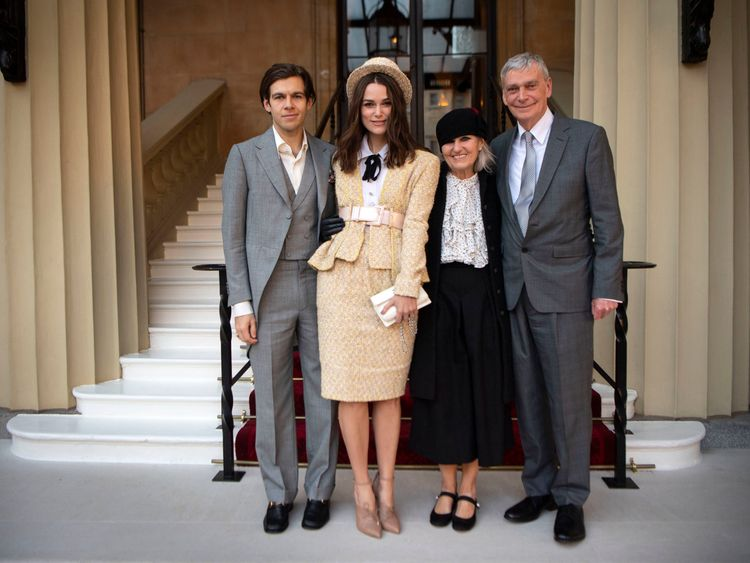 Keira Knightley with her husband, James Righton (left), and her parents, Sharman Knightley and Kevin William Knightley, as she arrives at Buckingham Palace, London to receive an OBE for her services to drama and charity at an Investiture ceremony