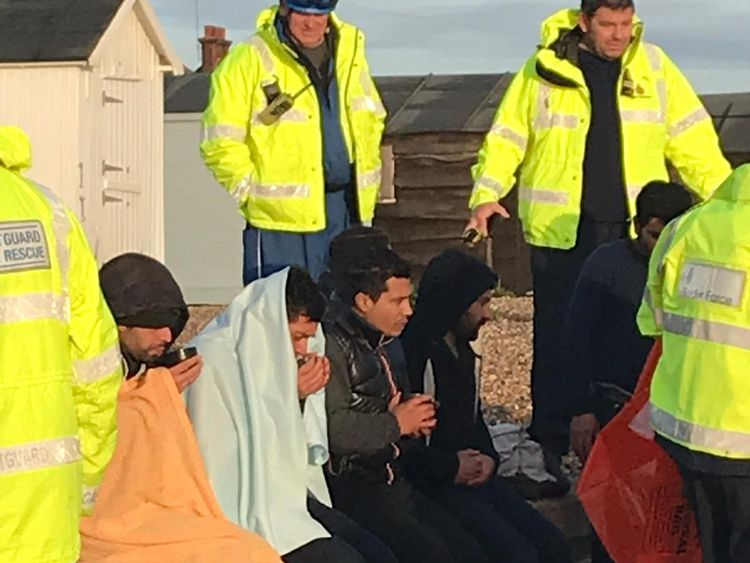 A group of suspected migrants on the beach at Kingsdown, Kent