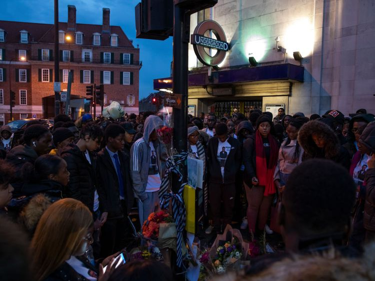 Friends and family gather at the scene of a fatal stabbing in November this year