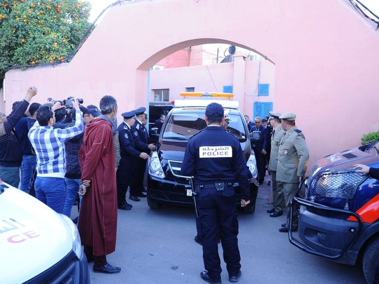 A picture taken on December 20, 2018, shows Moroccan police officers waiting outside a morgue in the capital Marrakesh, ahead of the transportation of the bodies of the two murdered Scandinavian hikers to the airport
