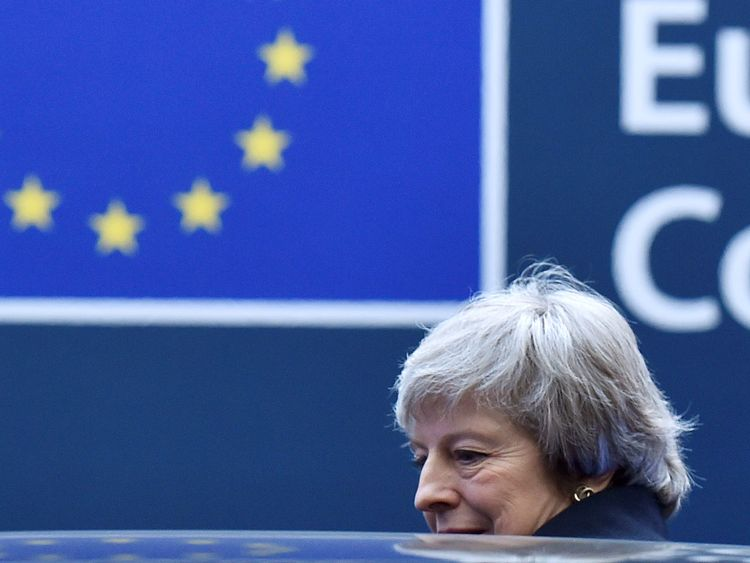 British Prime Minister Theresa May leaves after a news conference following a European Union leaders summit in Brussels