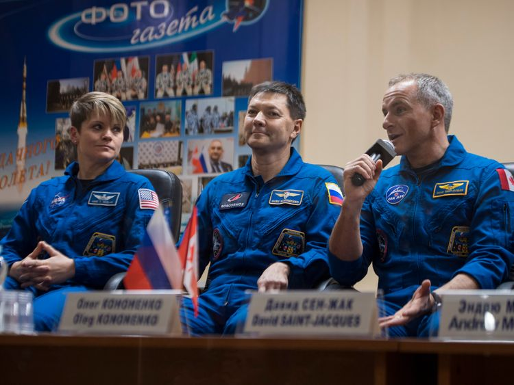 Expedition 58 Flight Engineer David Saint Jacques answers a question during a press conference Sunday Dec. 2 2018 at the Cosmonaut Hotel in Baikonur Kazakhstan. He is seen with fellow crewmates Flight Engineer Anne Mc Clain of NASA left and Soyuz Com
