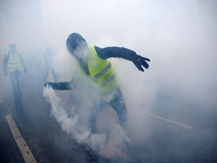 Tear gas was fired at the protesters, some of whom hurled objects at police