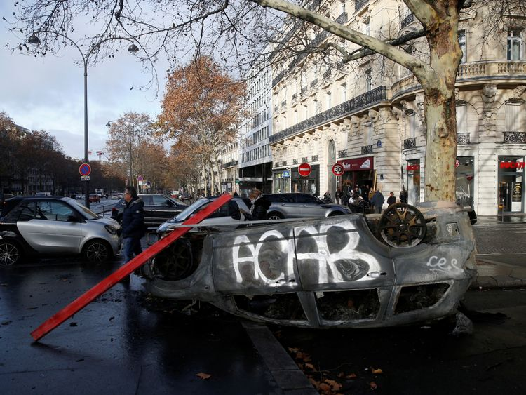 A vandalised car is seen the morning after protests turned violent