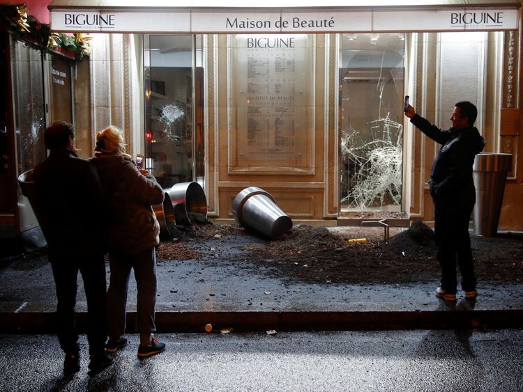 Shops were vandalised in a third weekend of demonstrations