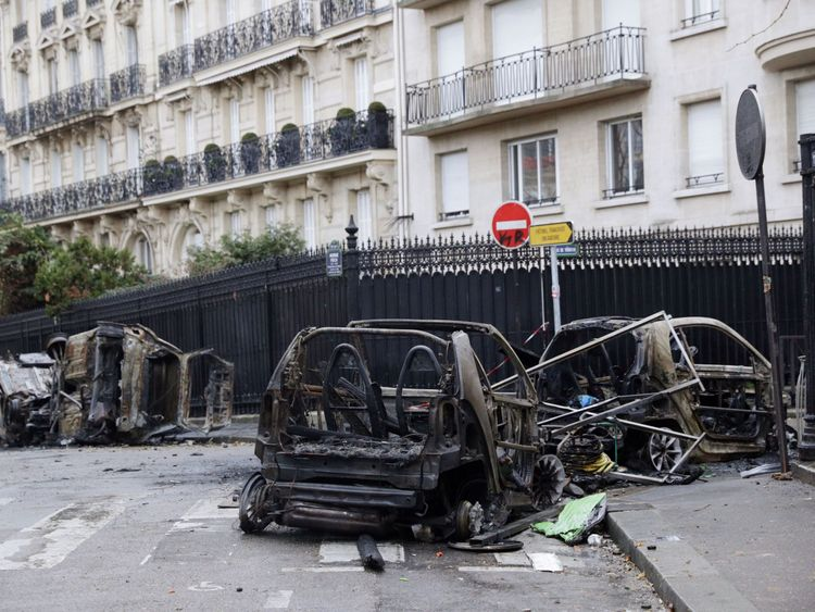 Burned cars litter the streets of Paris following Saturday's unrest