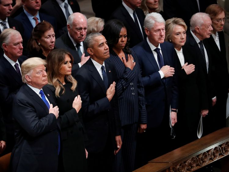 Former US presidents and their wives attend the former president's funeral service