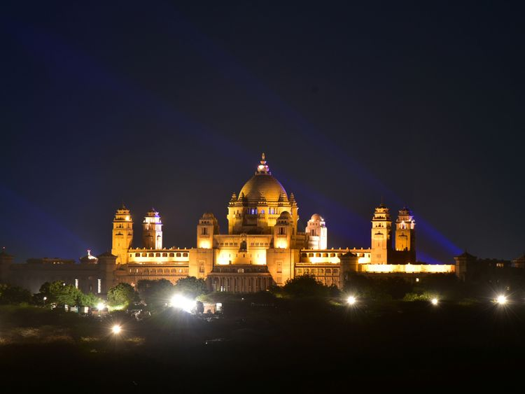A view of the illuminated Umaid Bhawan Palace the couple's wedding venue