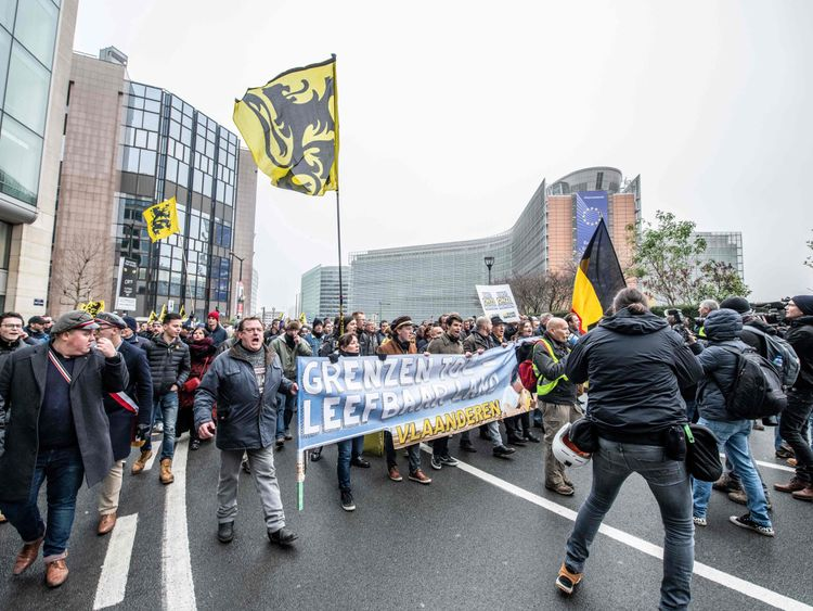 Police, anti-migration protesters clash at European Union headquarters