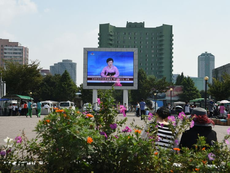 Ms Ri announces the news on a big screen in front of Pyongyang railway station