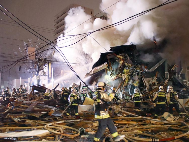 Firefighters operate at the site where a large explosion occurred at a restaurant in Sapporo, Hokkaido, northern Japan on December 16, 2018. Pic: Kyodo