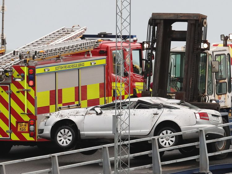 A crushed car is lifted off the European Causeway, a P&O Ferry which was travelling from Larne in Northern Ireland to Cairnryan Ferry Terminal, Wigtownshire, when it was caught in high winds. PRESS ASSOCIATION Photo. Picture date: Tuesday December 18, 2018. Several ambulances were sent to the scene along with police, the fire and rescue service and the coastguard, after six vehicles shifted on board the ferry, causing damage. See PA story POLICE Ferry. Photo credit should read: Andrew Millligan/