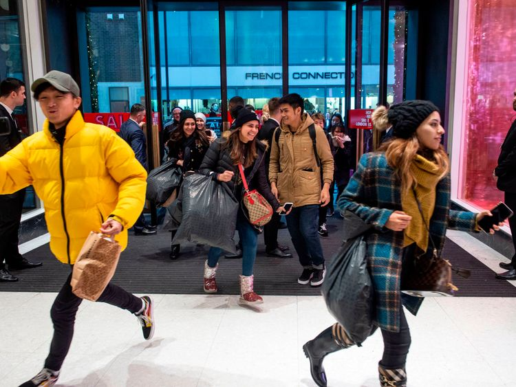 Shoppers run into the store as the doors of Selfridges open