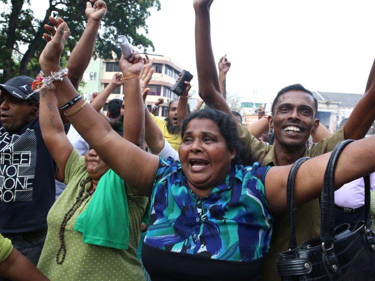 Sri Lanka reinstates ousted prime minister