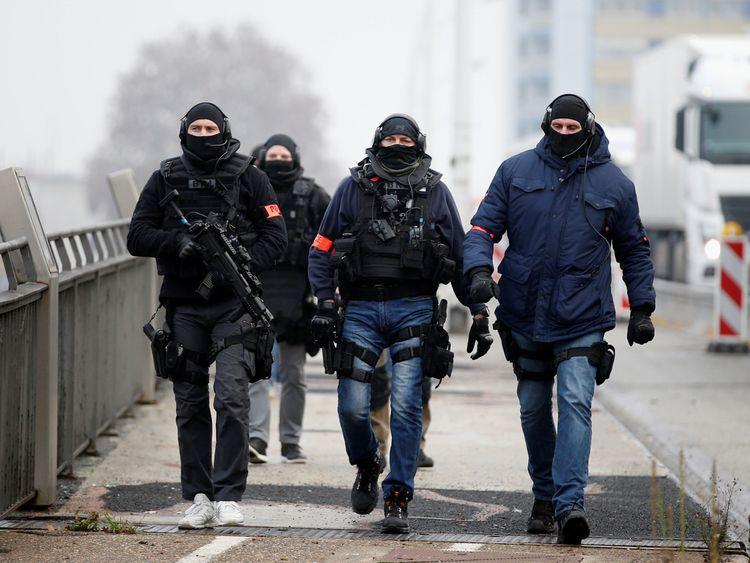 Members of French special police forces of Research and Intervention Brigade (BRI) patrol at the French-German border