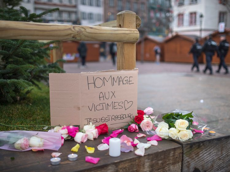 People have started to leave flowers for the victims near the scene of the attack