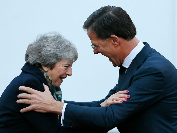 Theresa May is greeted by Dutch Prime Minister Mark Rutte upon her arrival in The Hague