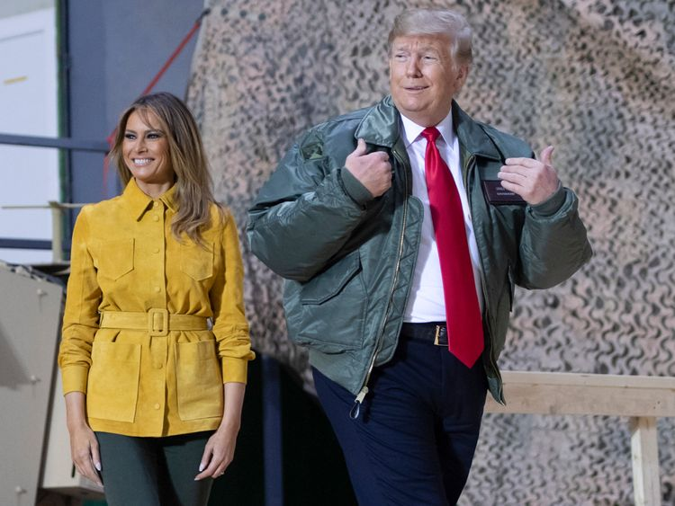 US President Donald Trump and First Lady Melania Trump arrive to speak to members of the US military during an unannounced trip to Al Asad Air Base in Iraq on December 26, 2018. - President Donald Trump arrived in Iraq on his first visit to US troops deployed in a war zone since his election two years ago (Photo by SAUL LOEB / AFP) (Photo credit should read SAUL LOEB/AFP/Getty Images)