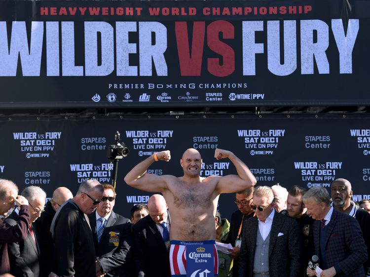 Tyson Fury poses during the Deontay Wilder v Tyson Fury weigh-in