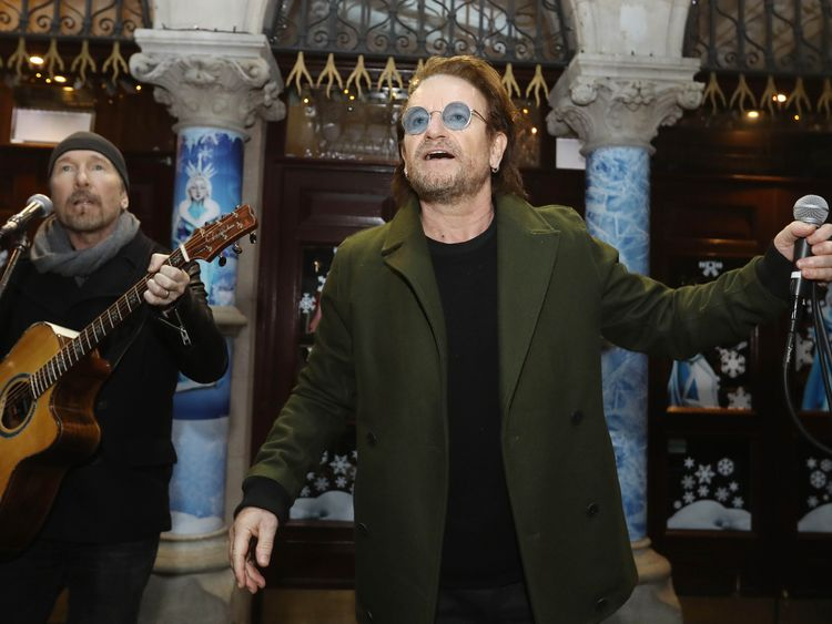 Bono does Christmas busking for homeless in Dublin
