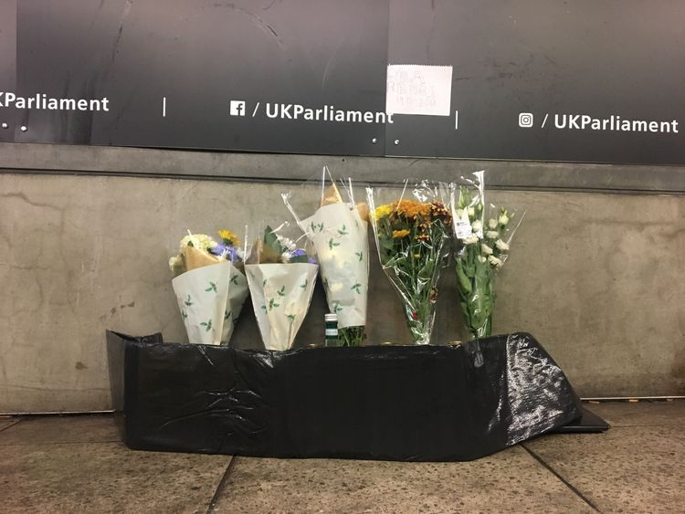 Tributes have been left at the scene where the man fell ill