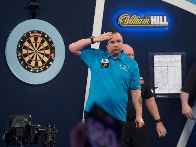 Alan Tabern of England in action against Raymond Smith of Australia during Day Two of the 2019 William Hill World Darts Championship at Alexandra Palace on December 14, 2018 in London, United Kingdom.
